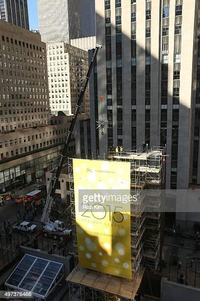 The Swarovski Star is hoisted on a crane at the Swarovski Star Raising For 2015 Rockefeller Center Christmas Tree at Rockefeller Plaza on November 16...