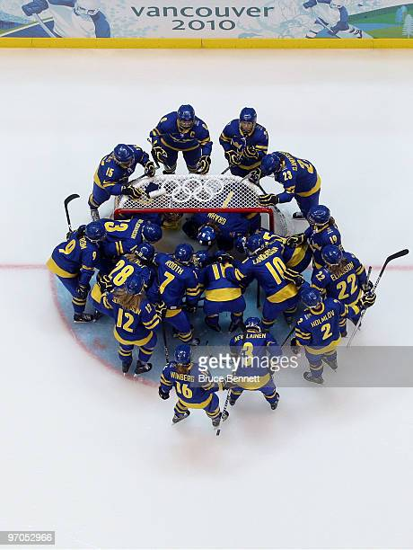 The Sweden team huddle up prior to face off during the ice hockey women's bronze medal game between Finland and Sweden on day 14 of the Vancouver...