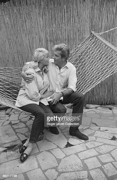 The Swedish actress Anita Ekberg and Rik Van Nutter her husband about 1965