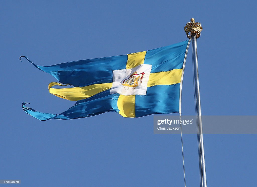 The Swedish flag flies over the Royal Palace as preparations for the wedding of Princess Madeleine of Sweden and Christopher O'Neill continues on June 7, 2013 in Stockholm, Sweden.