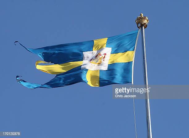 The Swedish flag flies over the Royal Palace as preparations for the wedding of Princess Madeleine of Sweden and Christopher O'Neill continues on...
