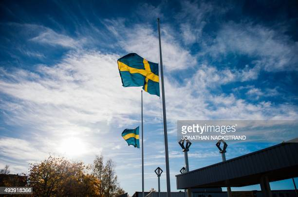 The Swedish flag flys at half mast near the primary and middle school Kronan in Trollhattan southwestern Sweden on October 23 where a masked man...