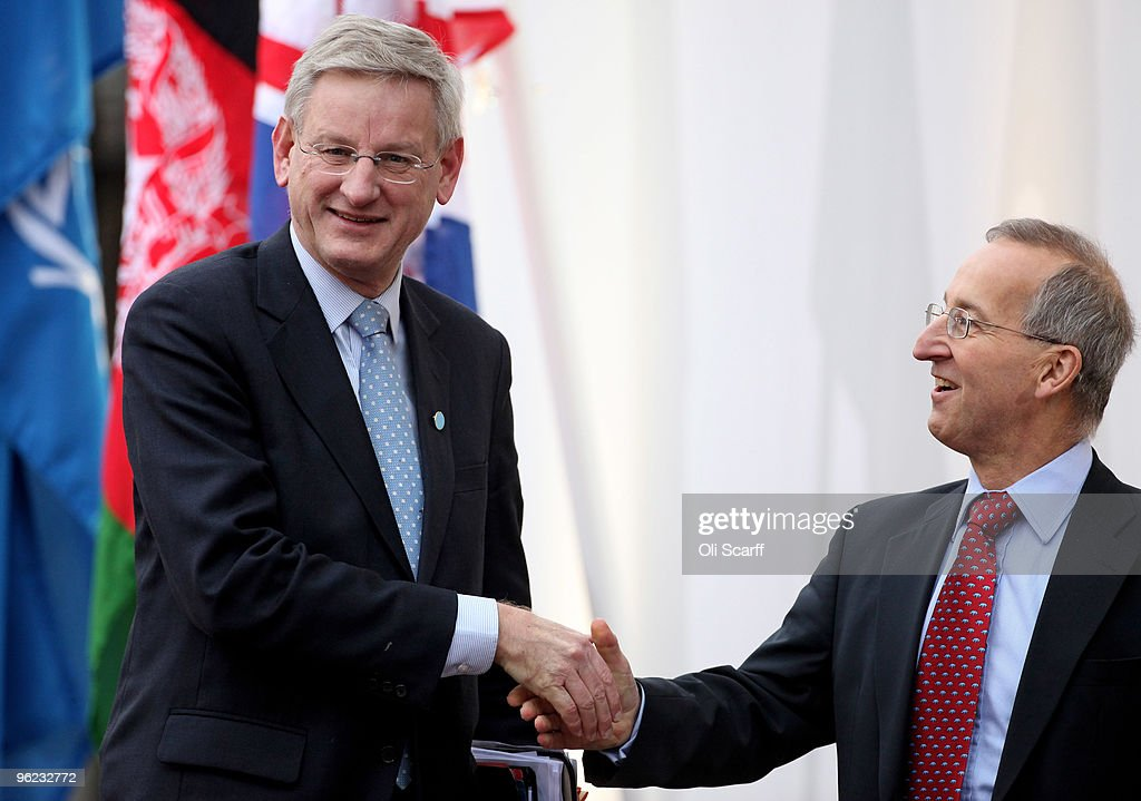 The Swedish Foreign Minister <a gi-track='captionPersonalityLinkClicked' href=/galleries/search?phrase=Carl+Bildt&family=editorial&specificpeople=3972090 ng-click='$event.stopPropagation()'>Carl Bildt</a> (L) is greeted by Permanent Under Secretary Sir Peter Ricketts (R) as he arrives to attend the Afghanistan London Conference at Lancaster House on January 28, 2010 in London, England. Foreign ministers from over 70 countries will attend the conference, co-hosted by British Prime Minister Gordon Brown, Afghan President Hamid Karzai and UN Secretary General Ban Ki-moon. Talks aims to tackle key issues on the future of Afghanistan and the gradual withdrawal of international troops from the country.