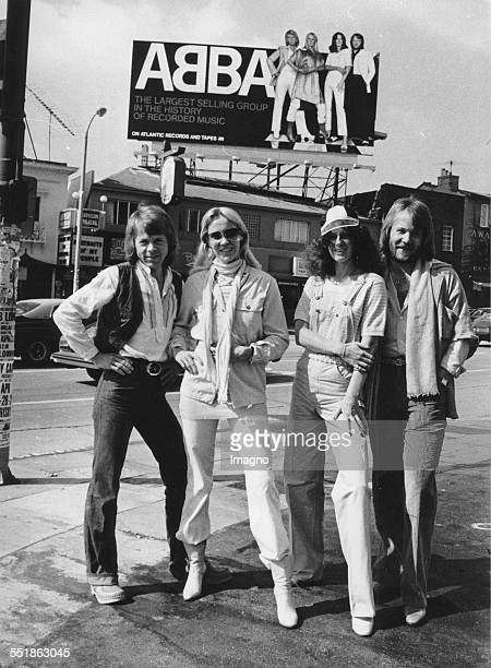 The Swedish pop group ABBA From left to right Björn Ulvaeus Agnetha Fältskog AnniFrid Lyngstad and Benny Andersson in front of a 7 high Poster of...