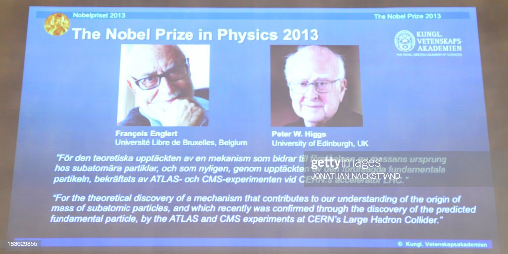 The Swedish Royal Academy of Sciences committee announces British theoretical physicist and Peter Higgs (R) and Belgian theoretical physicist Francois Englert as the laureates the 2013 Nobel Prize in Physics during a press conference on October 8, 2013 at the Nobel Assembly at the Royal Swedish Academy of Sciences in Stockholm. NACKSTRAND