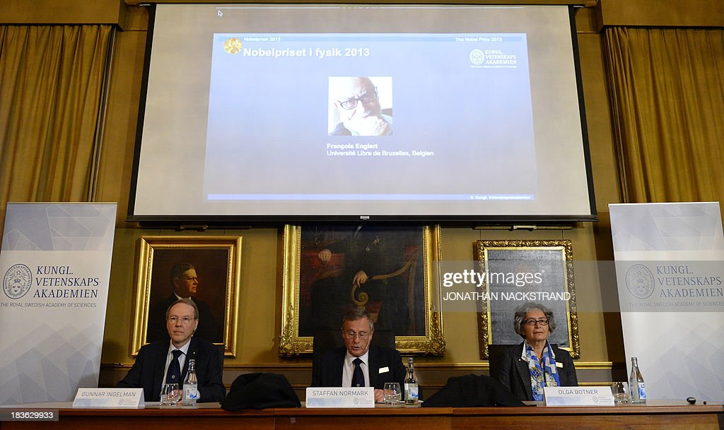 The Swedish Royal Academy of Sciences committee members (From L) Gunnar Ingelmann, Steffan Normark and Olga Botner announces British theoretical physicist and Peter Higgs and Belgian theoretical physicist Francois Englert (on screen) as the laureates the 2013 Nobel Prize in Physics during a press conference on October 8, 2013 at the Nobel Assembly at the Royal Swedish Academy of Sciences in Stockholm. NACKSTRAND
