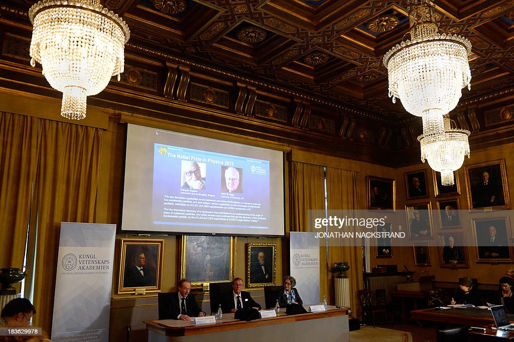 The Swedish Royal Academy of Sciences committee members (From L) Gunnar Ingelmann, Steffan Normark and Olga Botner announces British theoretical physicist and Peter Higgs and Belgian theoretical physicist Francois Englert as the laureates the 2013 Nobel Prize in Physics during a press conference on October 8, 2013 at the Nobel Assembly at the Royal Swedish Academy of Sciences in Stockholm. NACKSTRAND