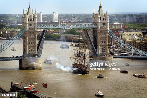 The Swedish ship Gtheborg a fullscale replica of an 18th Century East India merchantman fires its cannons after passing under Tower Bridge for which...