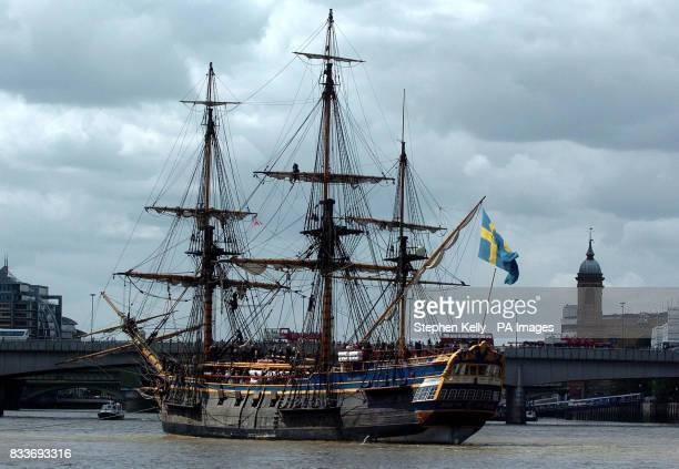 The Swedish ship Gtheborg a fullscale replica of an 18th Century East India merchantman passes close to Tower Bridge for which its road gates were...