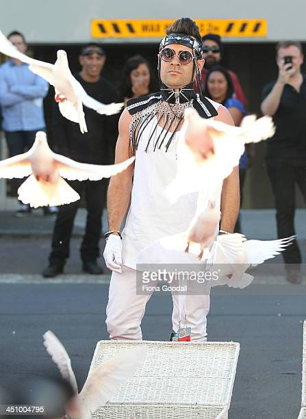 The Sweet Mix Kids release doves as they arrive at the New Zealand Music Awards at Vector Arena on November 21 2013 in Auckland New Zealand
