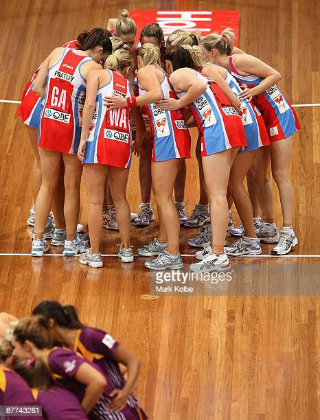 The Swifts team form a huddle before the start of the round seven ANZ Championships match between the Sydney Swifts and the Queensland Firebirds at...