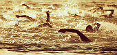The swimmer's silhouette during the early racing in swimming