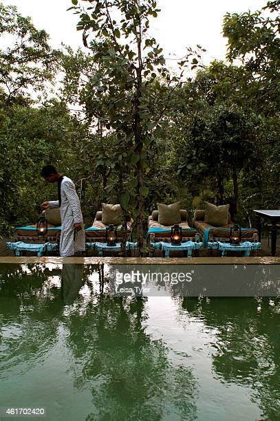 The swimming pool at Baghvan a newly opened safari lodge on the outskirts of Pench National Park Opening in late 2007 Baghvan is a collaboration...