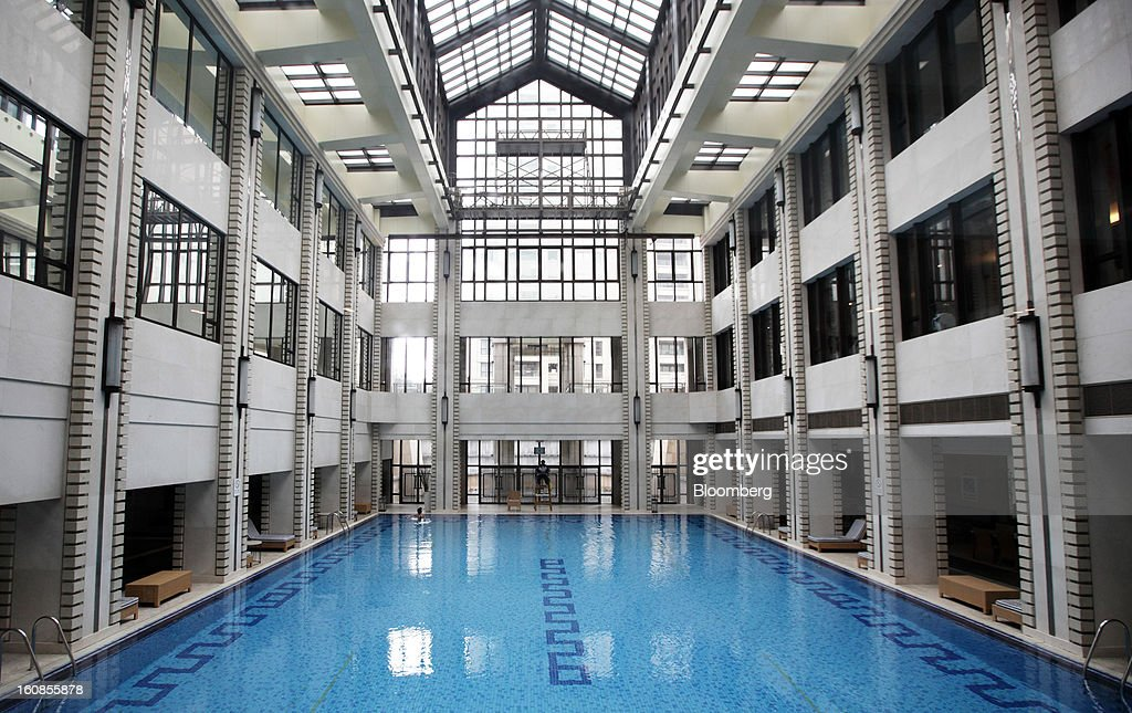 The swimming pool in the club house for Lakeville Regency, a residential property developed by Shui On Land Ltd., is seen in Shanghai, China, on Wednesday, Feb. 6, 2013. China's economic growth accelerated for the first time in two years as government efforts to revive demand drove a rebound in industrial output, retail sales and the housing market. Photographer: Tomohiro Ohsumi/Bloomberg via Getty Images