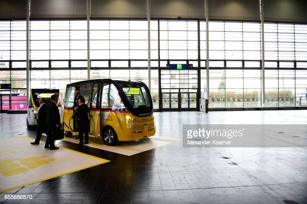 The Swiss Post Smartshuttle an autonomous electric transportation system is presented at the CeBIT 2017 Technology Trade Fair on March 20 2017 in...