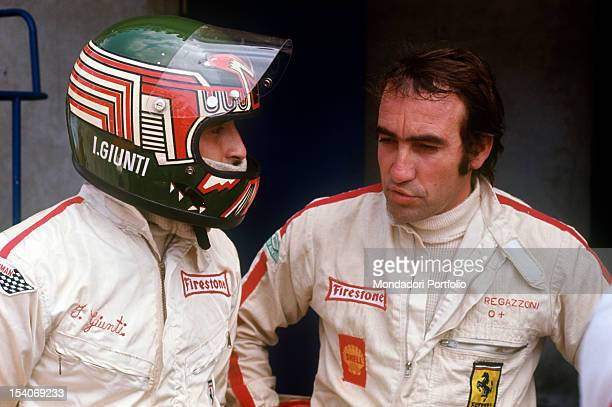 The Swiss racing car driver Clay Regazzoni and the Italian racing car driver Ignazio Giunti talking on the track Monza August 1970