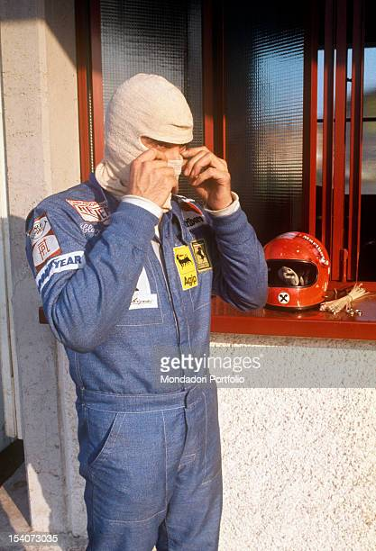 The Swiss racing car driver Clay Regazzoni getting ready before a test on track on a Ferrari 312 B374 Fiorano May 1974