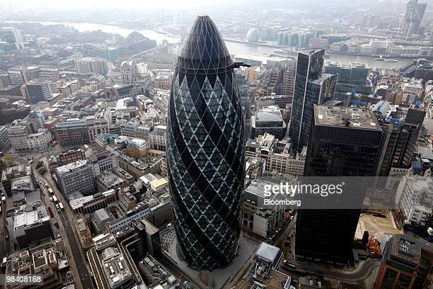 The Swiss Re Insurance building also known as 'the Gherkin' center and the headquarters of Aviva Plc St Helen's house right stand in the financial...
