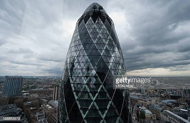 The Swiss Re tower or 'Gherkin' is pictured in the City of London on August 12 2010 AFP PHOTO/Leon Neal