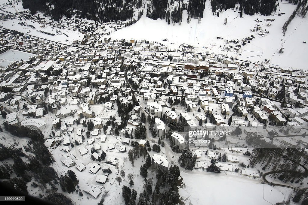 The Swiss resort of Davos stands covered in snow in this aerial photograph taken from a helicopter near Davos, Switzerland, on Tuesday, Jan. 22, 2013. World leaders, Influential executives, bankers and policy makers arrive in the Swiss Alps for the 43rd annual meeting of the World Economic Forum in Davos, the five day event runs from Jan. 23-27. Photographer: Simon Dawson/Bloomberg via Getty Images