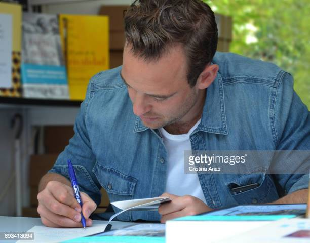 The swiss writer Joel Dicker signs a book during the Book Fair 2017 at El Retiro Park on June 3 2017 in Madrid Spain