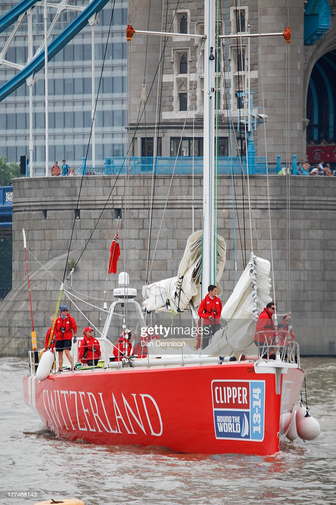 The 'Switzerland', one of 12 race yachts competing in The Clipper 2013-14 Round The World Yacht Race, prepares to moor in St Katherine's Dock, east London on August 23, 2013. The 40,000 mile, 8-leg course begins on September 1 and will visit six continents, taking eleven months to complete.on August 23, 2013 in London, England.