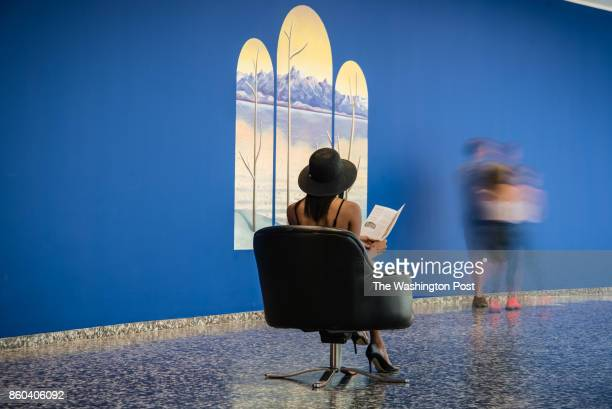 The swivel chairs on the third level inner ring of the Hirshhorn Museum in front of Nicolas Party's installation sunrise sunset Arts section story on...