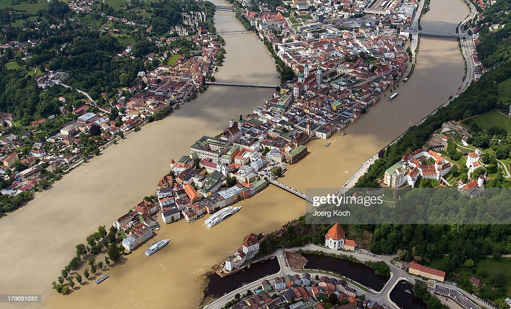 The swollen Danube river (right) and the Inn river (left) have flooded parts of the historical city of Passau on June 6, 2013, Germany. Eastern and southern Germany are suffering under floods that in some cases are the worst in 400 years. At least four people are dead and tens of thousands have evacuated their homes.