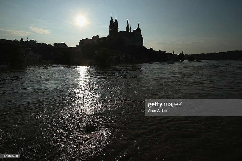 The swollen Elbe river churns past the flooded historic city center on June 6, 2013 in Meissen, Germany. Eastern and southern Germany are suffering under floods that in some cases are the worst in 400 years. At least four people are dead and tens of thousands have evacuated their homes.