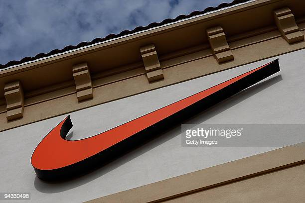 The 'Swoosh' logo is seen on a Nike factory store on December 12 2009 in Orlando Florida Tiger Woods announced that he will take an indefinite break...