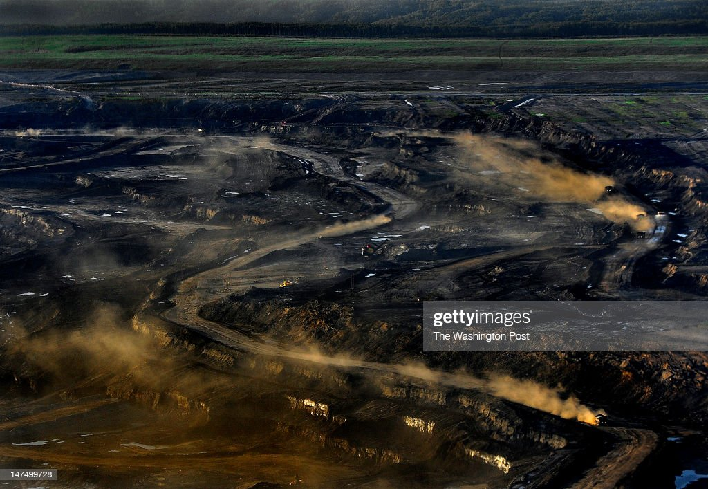 The Sycrude oils sands open pit mine uses trucks that are 3 stories tall weigh one million pounds and cost 7 million dollars each There is explosive...