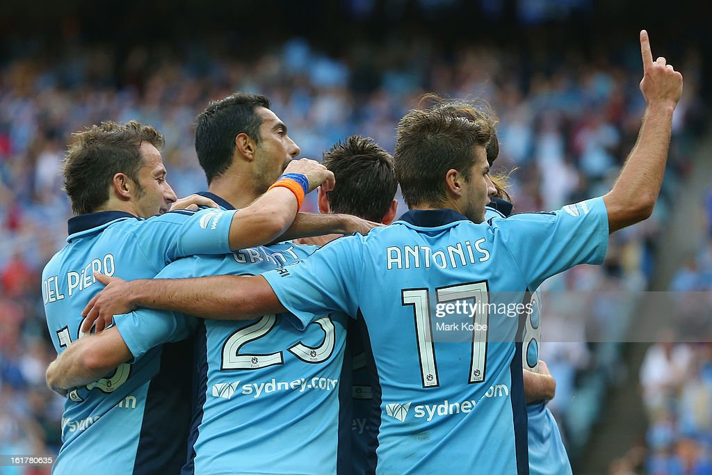 The Sydney FC players congratulate Blake Powell of Sydney FC as he celebrates scoring a goal during the round 21 A-League match between Sydney FC and Adelaide United at Allianz Stadium on February 16, 2013 in Sydney, Australia.