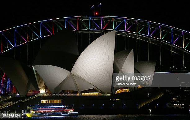 The Sydney Harbour Bridge is illuminated with rainbow colors to remember victims of the Orlando night club massacre on June 13 2016 in Sydney...