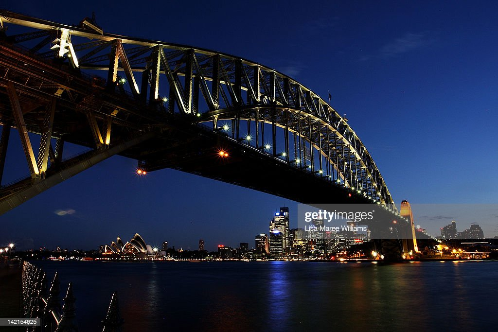 The Sydney Harbour Bridge is seen before the lights are switched off for Earth Hour on March 30 2012 in Sydney Australia Earth Hour encourages...