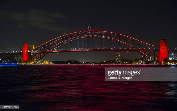 the Sydney Harbour Bridge lit red to celebrate Chinese New Year on January 27 2017 in Sydney Australia A number of events are being held across...