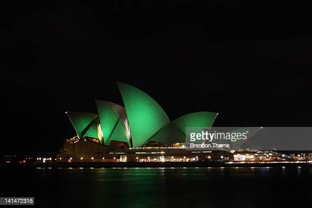 The Sydney Opera House is illuminated green on March 17 2012 in Sydney Australia The Sydney Opera House joins Sky Tower in Auckland and Table...