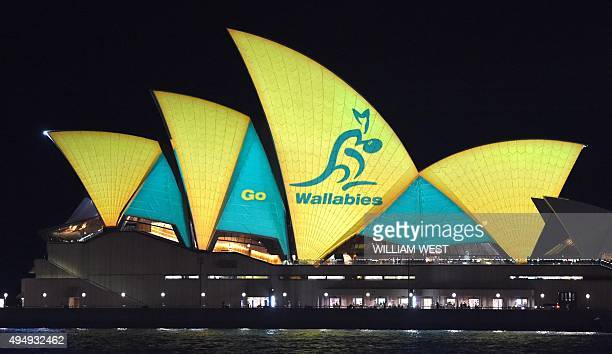 The Sydney Opera House is lit up in Australian colours on October 30 to support the Australian Wallabies rugby union team who take on the New Zealand...