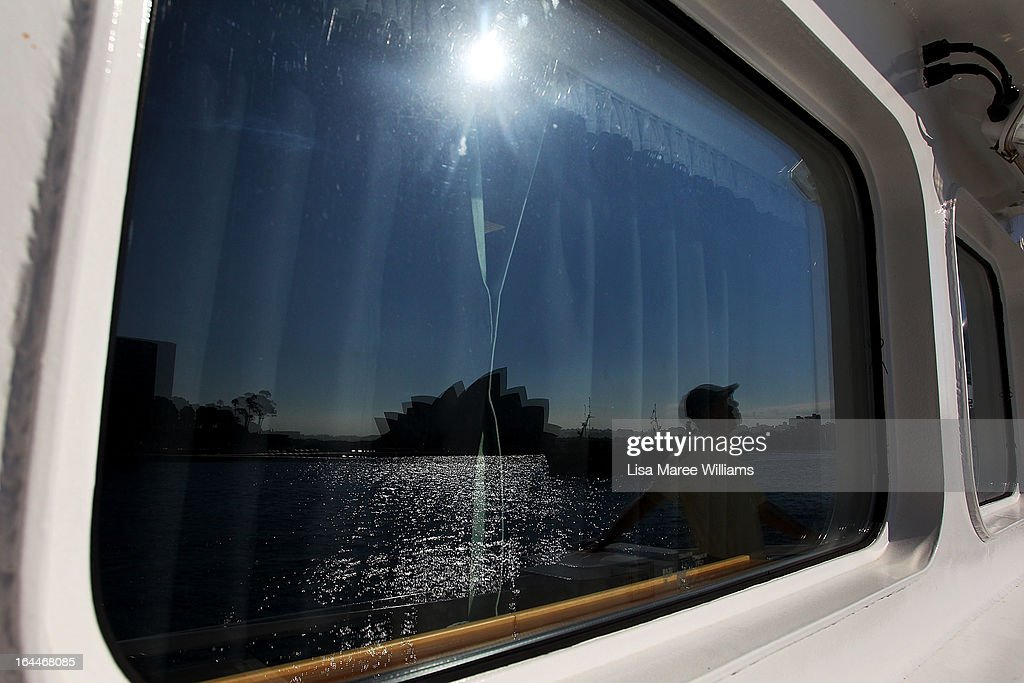 The Sydney Opera House is reflected in a window aboard the Greenpeace Rainbow Warrior at the Overseas Passenger Terminal in Circular Quay on March 24, 2013 in Sydney, Australia. The vessel is in Australia to protest new coal mines set to open near the Great Barrier Reef, and is opening for public viewing at ports across the country. The original Rainbow Warrior was bombed and sunk in Auckland Harbour in 1985 by two French intelligent agents, killing a Dutch photographer on board.