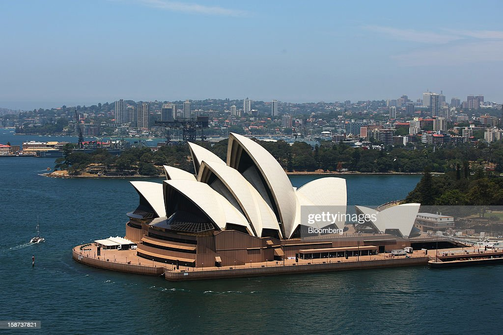 The Sydney Opera House is viewed from the arch of the Sydney Harbour Bridge in Sydney, Australia, on Monday, Dec. 24, 2012. Beginning next month, people wanting to ascend 134 meters above sea level to the top of the bridge spanning Sydney Harbour will have the option to hear guides speak Mandarin. Photographer: Brendon Thorne/Bloomberg via Getty Images