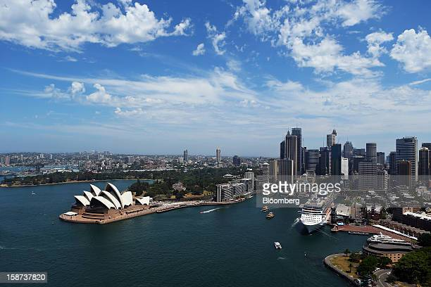 The Sydney Opera House left and the Overseas Passenger Terminal at Circular Quay right are viewed from the arch of the Sydney Harbour Bridge in...