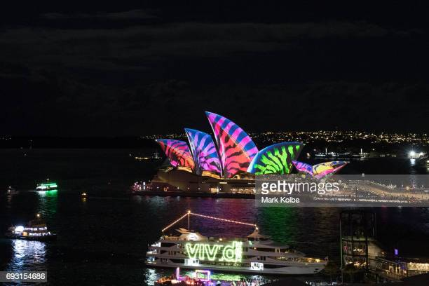 The Sydney Opera House sails and surrounds are lit as part of the Vivid Festival on June 6 2017 in Sydney Australia Vivid Sydney is an annual...
