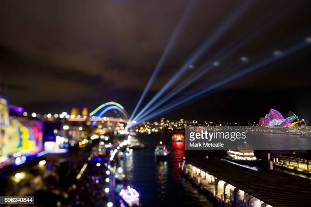 The Sydney Opera House sails and the Sydney Harbour Bridge are lit as part of the Vivid Festival on June 15 2017 in Sydney Australia Vivid Sydney is...