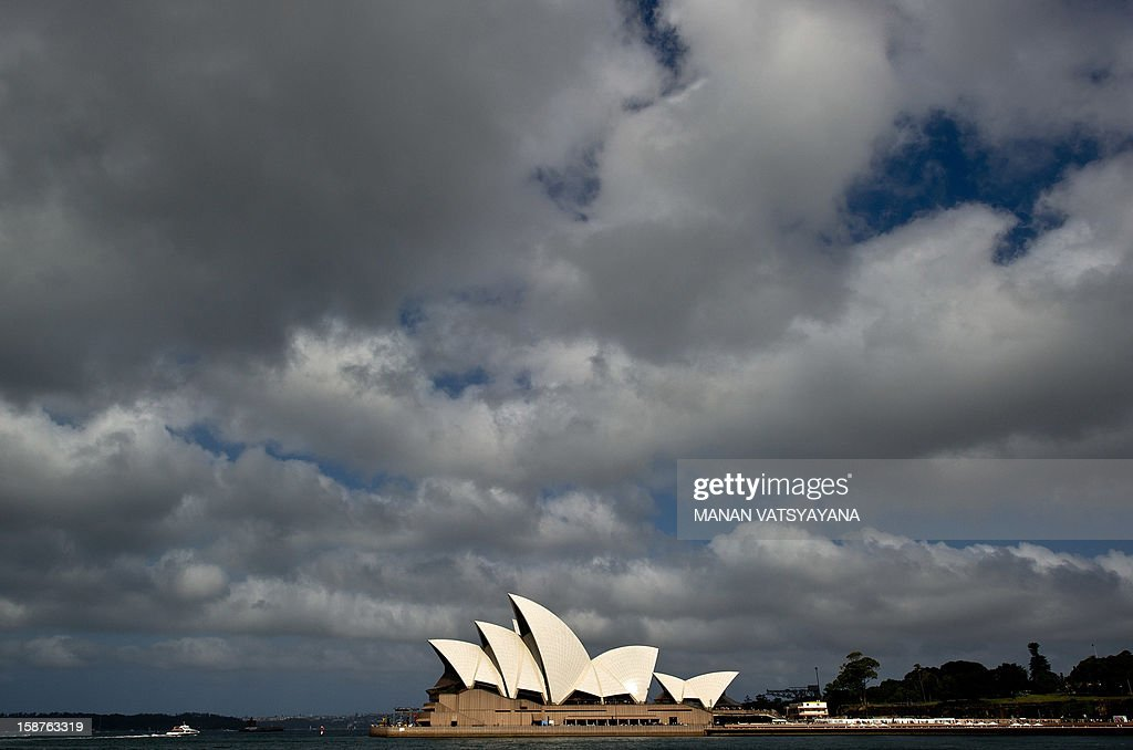 The Sydney Opera House, the city's iconic landmark is seen on a cloudy afternoon in Sydney on December 28, 2012. The world famous Australian centre for the performing arts is a venue for well known Australian and international performing artists including ballet, musical and theater.