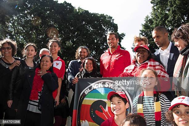 PARK SYDNEY NSW AUSTRALIA The Sydney Swan's Lance Franklin and former player Michael OLoughlin pose with fans at the launch of their Reconciliation...