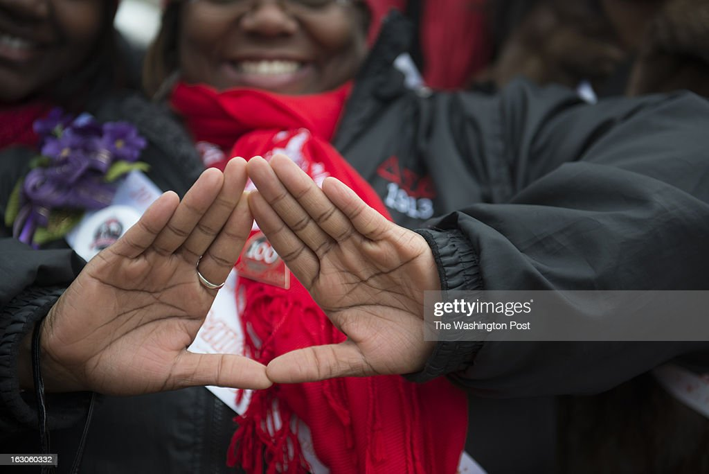 The symbol of Delta Sigma Theta Sorority, Inc is displayed for the camera in Washington, D.C. on March 03, 2013. Deltas gathered on the West Front of the United States Capitol and then marched past the White House and finally ended their march on the grounds of the Washington Monument. Members of Delta Sigma Theta Sorority, Inc., the single largest predominantly African-American women's organization in the country, retraced the footsteps of their founders who participated in the Women's Suffrage March of 1913. Thousands of the Sorority's members accompanied by other invited organizations, to commemorate the 100th anniversary of the role the 22 Founders of Delta Sigma Theta Sorority played in the 1913 Women's Suffrage March. Guided by the event's theme, 'Tracing the Footsteps of our Founders,' members of the Sorority will follow the symbolic route down Pennsylvania Avenue, and assembled on the grounds of the Washington Monument.