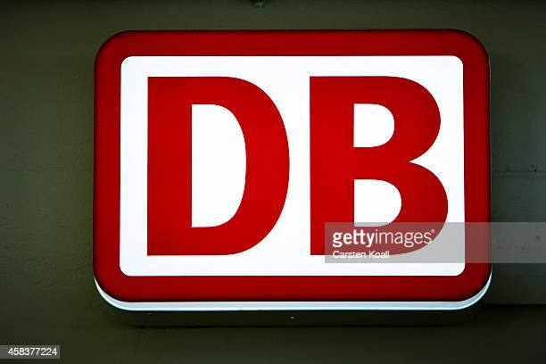 The symbol of the 'Deutsche Bahn' railway company is seen at the railway station at Alexanderplatz on November 4 2014 in Berlin Germany Germany is...