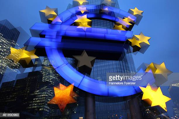 The symbol of the Euro the currency of the Eurozone stands illuminated on January 21 2015 in Frankfurt Germany The European Central Bank is schedule...