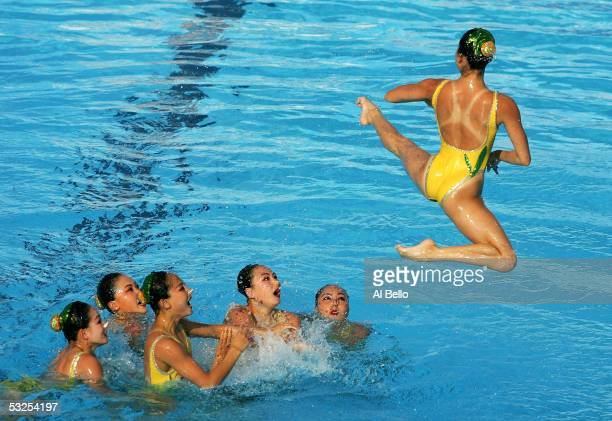 The synchronized swimming team from North Korea perform their free routine during the XI FINA World Championships at the Parc JeanDrapeau on July 18...