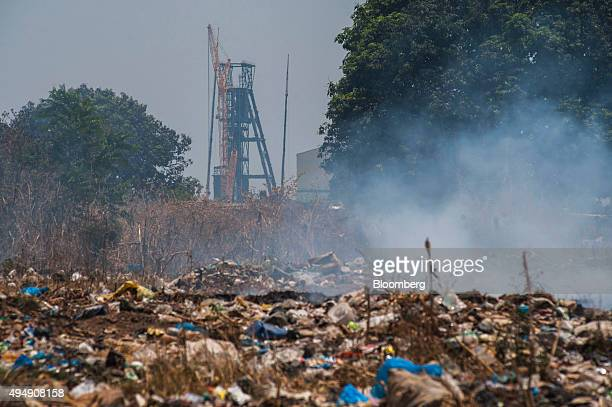 The Synclinorium shaft sits beyond a field of smouldering garbage near the Mopani copper mine a Zambian unit of Glencore Plc in Kitwe Zambia on...