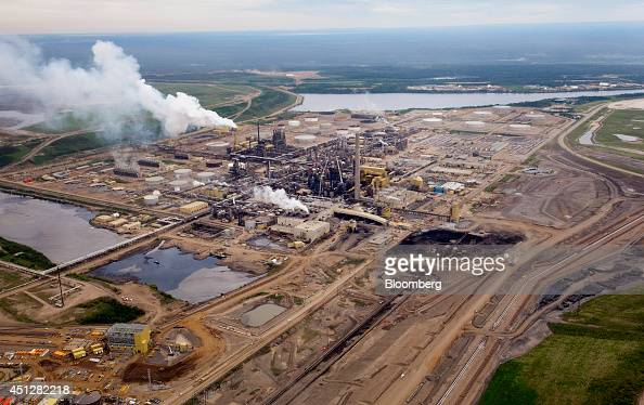 The Syncrude Canada Ltd base plant stands in this aerial photograph taken above the Athabasca Oil Sands near Fort McMurray Alberta Canada on...